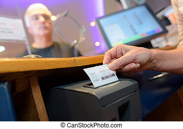 assistant serving customers taking order and print receipt