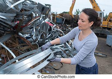 woman at a junkyard