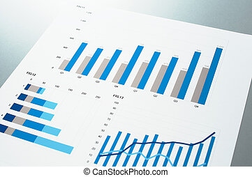 Close up of blue charts. Business document. - Report on gray...