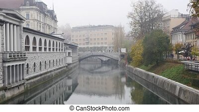 Ljubljanica river and Three bridges in the background,...