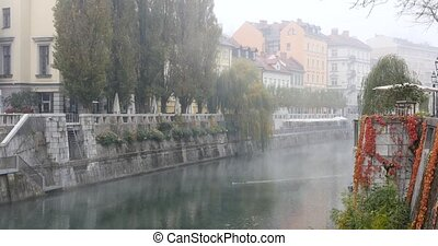 Ljubljanica river and buildings in the background, Slovenia