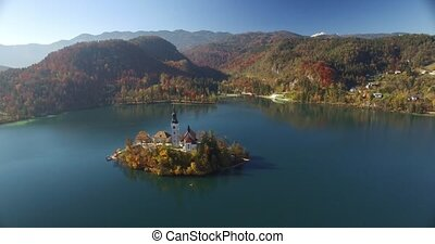 Aerial view of St Martin church on island and Bled lake...