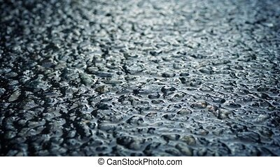 Moving Over Wet Road Surface Macro - Macro tracking shot of...