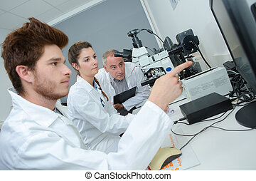 group of young apprentices at a lab