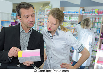 customer showing prescription to pharmacist