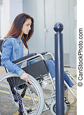 woman with wheelchair outdoors