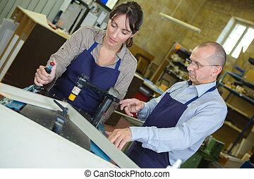 metallurgy workers in workshop