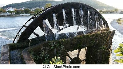 a water wheel to lift water for irrigation of grape fields...