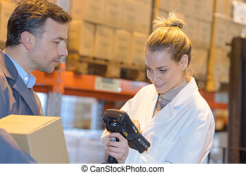 male and female in warehouse