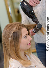blonde woman happy to get her hair cut