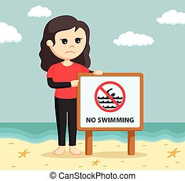female lifeguard with no swimming sign