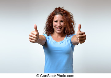 Enthusiastic motivated woman giving a thumbs up