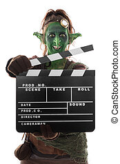 Goblin or imp holding a clapperboard, isolated on white