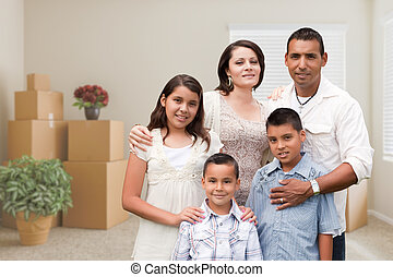 Hispanic Family in Empty Room with Packed Moving Boxes and Potted Plants