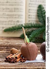 Glazed in chocolate apple for christmas and music sheet