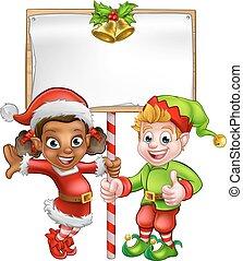 Cartoon Christmas Elves Holding Sign - Cute cartoon girl and...