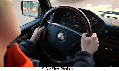 Male hands on steering wheel SUV car - Both man's hands on...