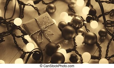 Christmas gift and lights on wooden background