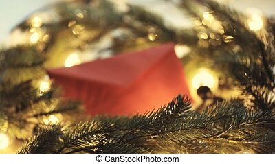 Christmas envelope and lights with pine branch on wooden...