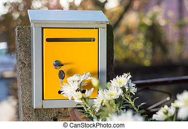 Mailbox with key insterted front of the house