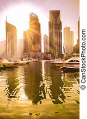 Luxury Dubai Marina against sunset in Dubai, United Arab Emirates.