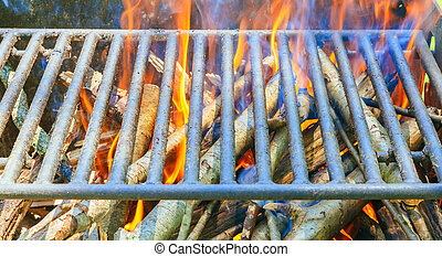 camp fire in pit at campsite - a camp fire in a fire pit at...