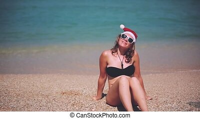 Christmas beach vacation santa claus hat woman in sunglasses...
