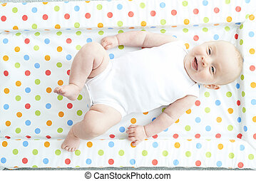 Overhead View Of Baby Girl Lying On Colorful Change Mat