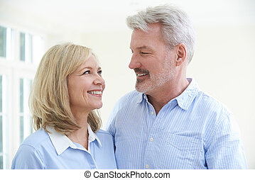 Happy Mature Couple At Home Together
