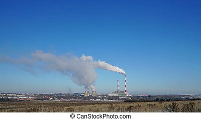 Thermal power plant or a factory with Smoking chimneys on...