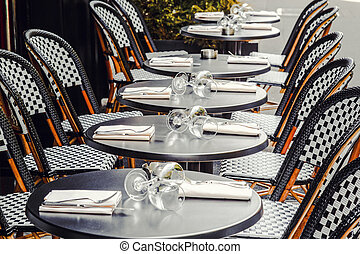 Table appointments in cafe on the street of Paris. - Table...
