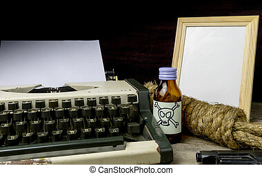Typewriter with paper page and poison and gun. Concept...