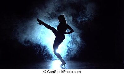 Woman dancing ballroom in the studio, silhouette. Slow...