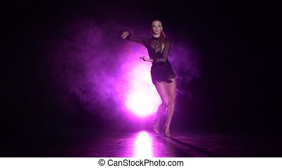 Dancer performs rumba dance in the studio. Slow motion -...