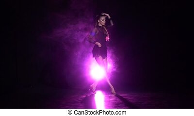 Dancer performs latin dance in the studio. Slow motion -...