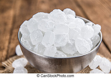 White Rock Candy on wooden background (detailed close-up...