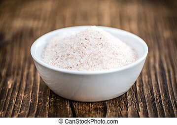 Portion of Himalayan Salt on wooden background (selective...