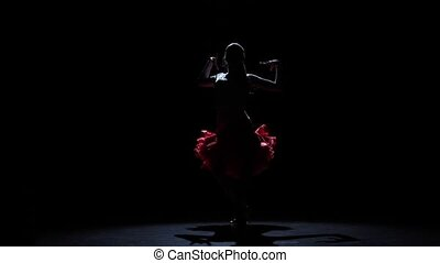 Girl dancing passionate samba dance, silhouette. Slow motion...
