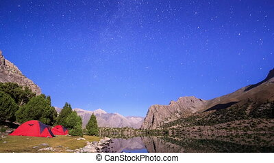 Moonlit night in the mountains. Time Lapse. Pamir,...