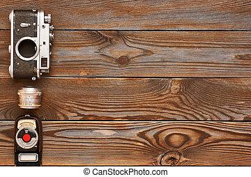 Vintage camera and lens on wooden background - Vintage old...