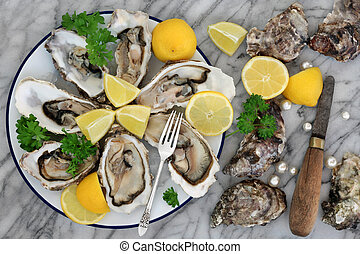 Oysters on crushed ice with antique oyster knife and silver...