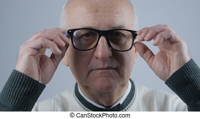 close up portrait of senior man with glasses and gray hair -...