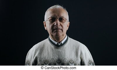 portrait of senior man with glasses and gray hair - portrait...
