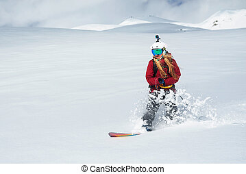 girl snowboarder rides fast on snow Freeride - girl...