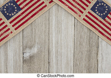 USA patriotic old flag on a weathered wood background with...