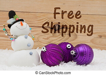 Free Shipping message, Some snow, Christmas ornaments and a...