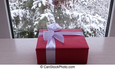 box of gift on the table in front of the window in the...