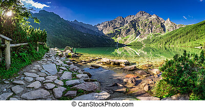 Beautiful lake in the mountains at dawn in summer