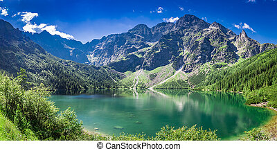 Stunning sunrise at lake in the Tatra Mountains in summer
