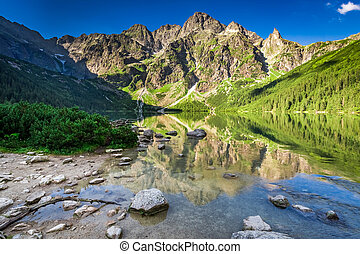 Beautiful sunrise at lake in the Tatra Mountains in Poland
